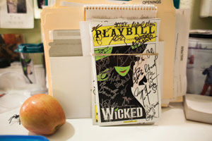 "A Playbill, signed by ""Wicked"" cast members, awaits a lucky fan."