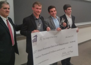(L–R): Dean of the School of Business William Keep presents the 1st Place prize of $12,000 to M&S Guitars: James Seyffart, Alex Matteson, and Tim Pfenninger. Photo (c) Deric Raymond '11