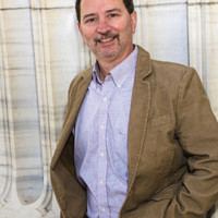 The writer in the white coat: '78 alumnus pursues longstanding dream to be an author