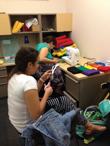 Students Cynthia Perez (left) and Robyn Beekman making masks that were delivered to children with serious illnesses or disabilities.