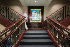 """A larger and bolder replica of the Athena-like image illuminates the landing on the lower level of the library staircase. Photo by """"The Star-Ledger,"""" Newark, NJ"""